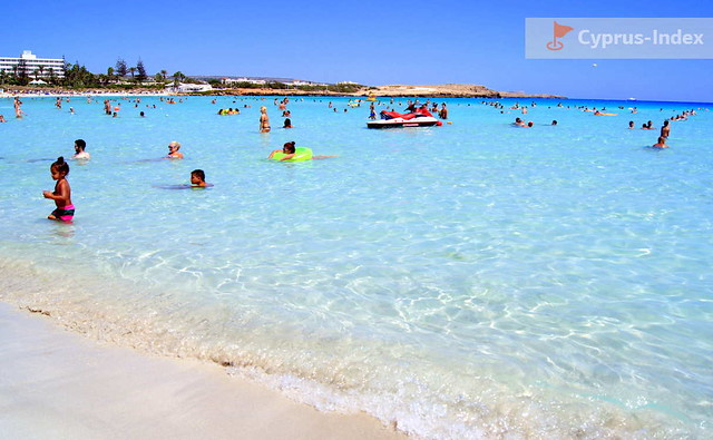 Bright sand and shallow water of Nissi Bay Beach, Ayia Napa, Cyprus