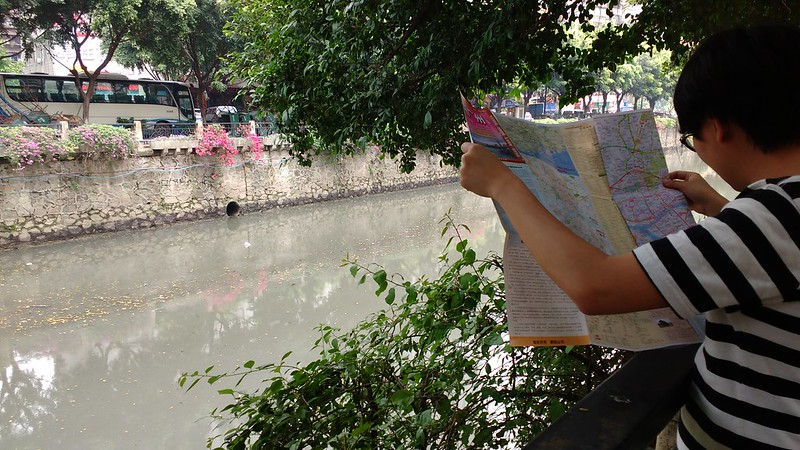 trevor looking at map, smelly river