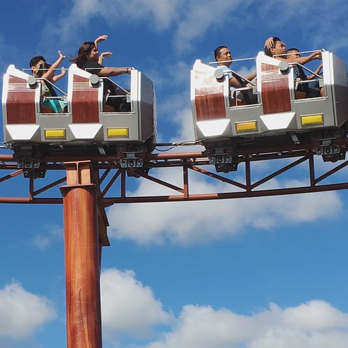 Raine enjoying the roller coaster at Skyranch. She rode it ...