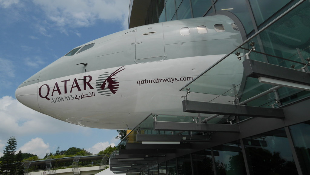 A decommissioned Boeing 737 sticks out of KidZania's glass façade