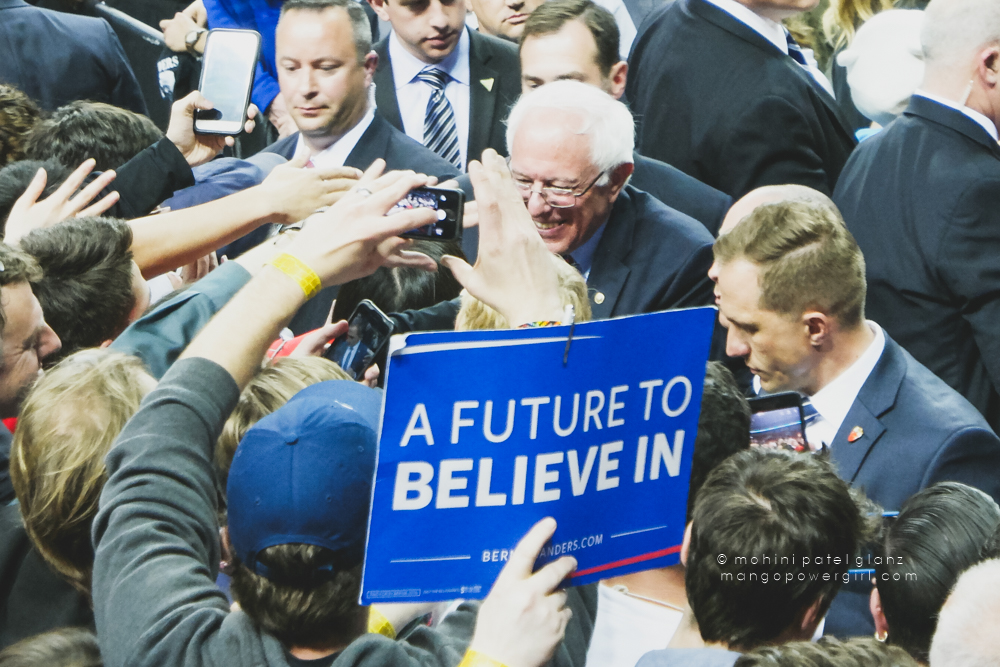senator bernie sanders smiling at a supporter at the seattle rally at key arena, seattle center