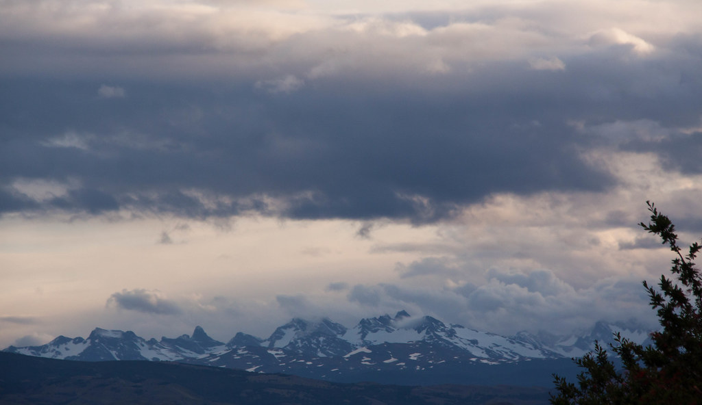 Snowcapped Mountains And Clouds At Torres Del Paine Pata Flickr