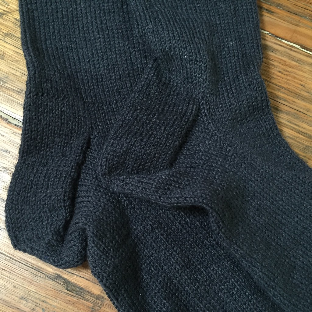 close up of heel section of a pair of socks knit in grey patonyle for my great uncle frank