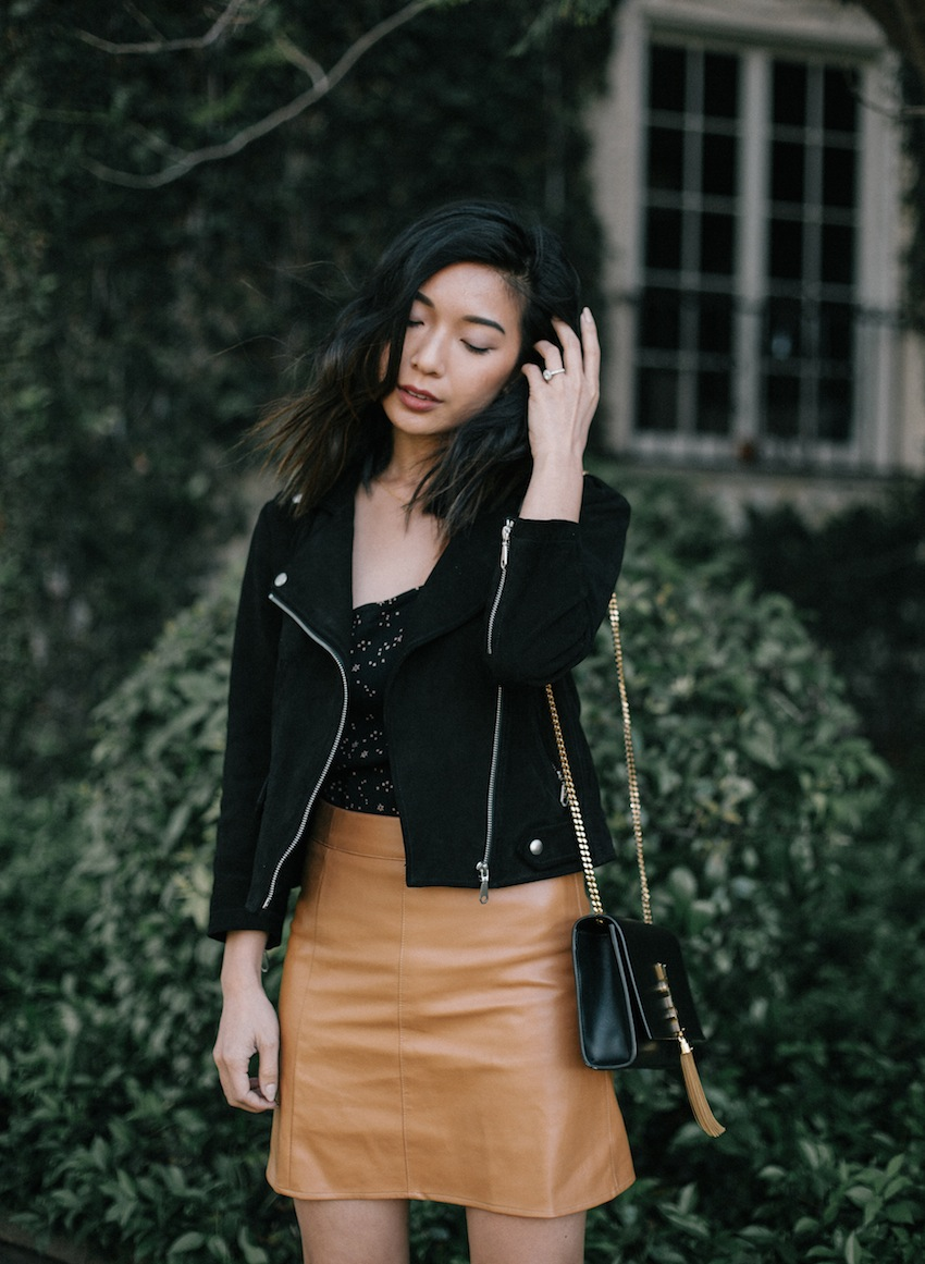 Stephanie Liu of Honey & Silk wearing Reformation star-print top, Saint Laurent tassel bag, and Rebecca Minkoff moto jacket.