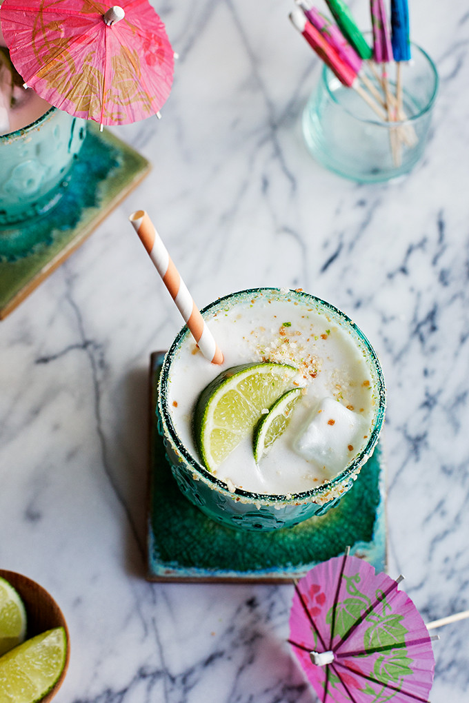 Creamy Coconut Margaritas--this margarita has all the usual suspects like lots of lime and tequila, plus a creamy coconut base and a salty toasted coconut and lime sugar rim!