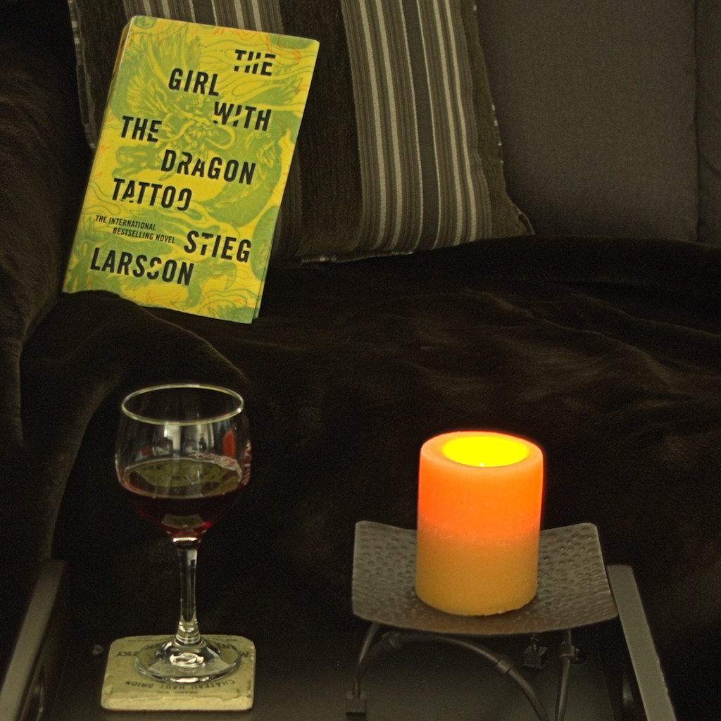 reading candle and glass of wine