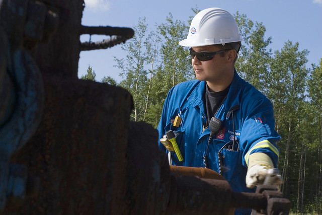 Photo of a worker at an oil site
