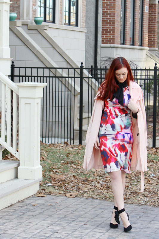 Floral dress with black pussy bow shirt underneath. Blush pink trench coat draped over my shoulders. Black heels with bows on the side.