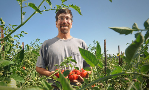 Oregon Farmer Chris Roehm with tomatoes
