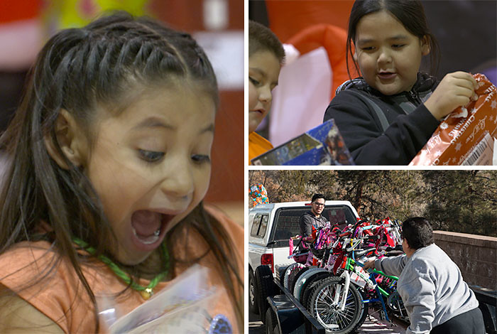 Northern New Mexico children excitedly open their gifts, while volunteers get ready to deliver bicycles.