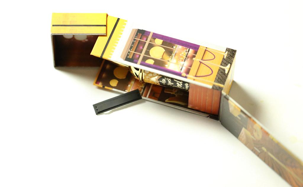 Element zabezpieczający umieszczony we wnętrzu pudełka