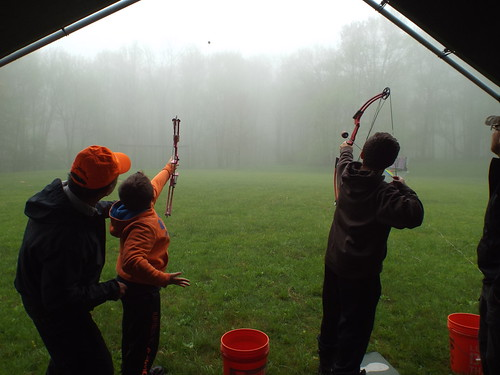 Photo of youth practicing archery