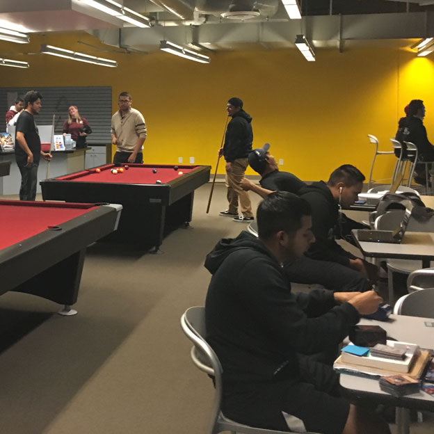Students playing pool at the Cal State Dominguez Hills Loke Student Union