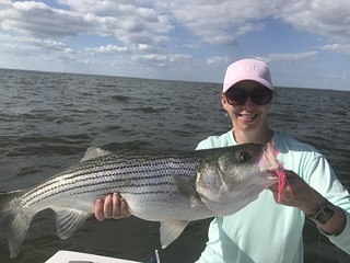Woman holding striped bass