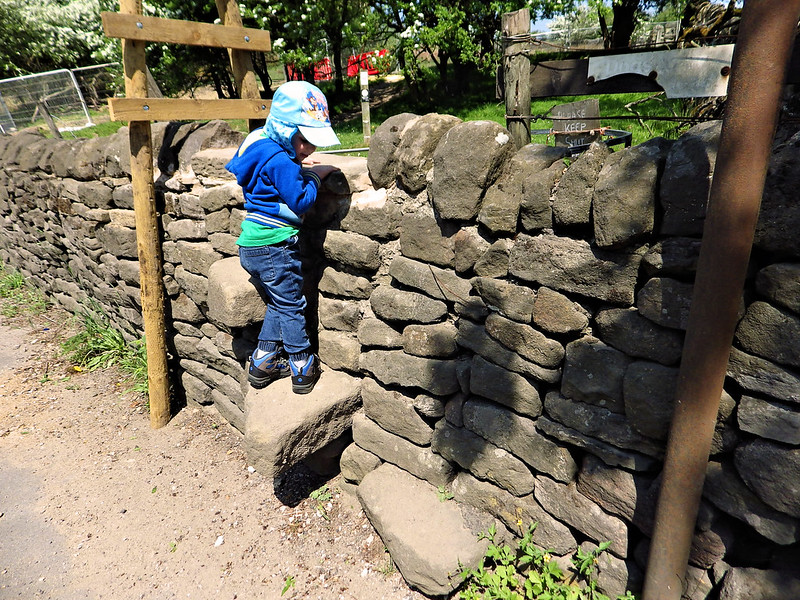 climbing over a stone stile