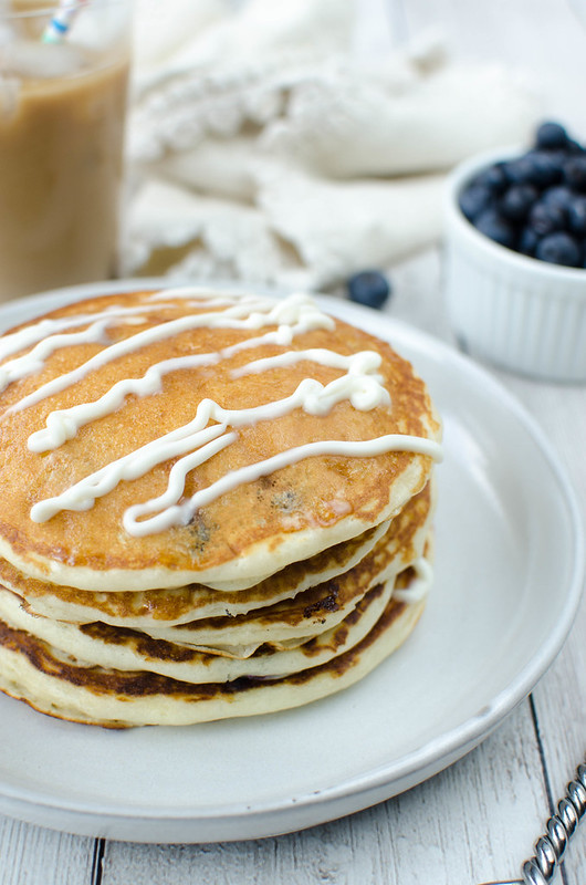 Blueberry Sour Cream Pancakes - the fluffiest, most delicious blueberry pancake recipe!