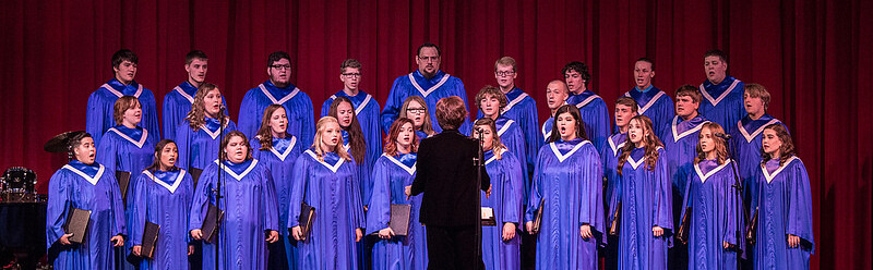 Sara Oberle directing choir