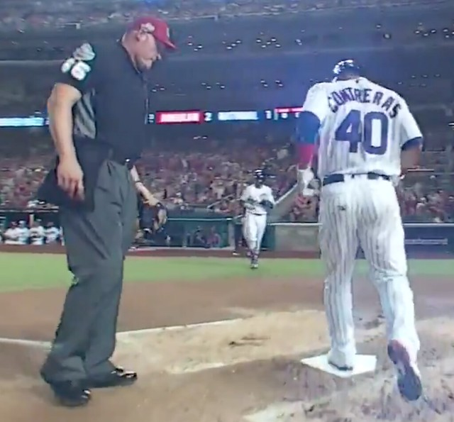 6c50e081b6c ... third base ump Andy Fletcher had switched to a tri-color pinwheel-style  cap