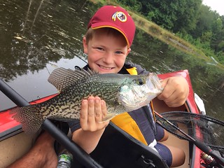 Photo of boy holding his catch of a crappie