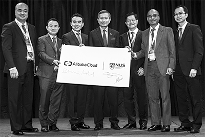 Alibaba Cloud & National University of Singapore sign MOU to support the Smart Nation initiative. (From left to right) Raymond Ma, General Manager, ASEAN, ANZ, Alibaba Cloud; Dr. Min Wanli, Chief Machine Intelligence Scientist, Alibaba Cloud; Yeming Wang, Business President, Alibaba Cloud; Dr. Vivian Balakrishnan, Minister for Foreign Affairs and Minister-in-Charge of the Smart Nation Initiative; Professor Bernard Yeung, Dean, NUS Business School; Professor Mohan Kankanhalli, Dean, NUS School of Computing; Associate Professor James Pang, Co-Director, NUS Business Analytics Centre.