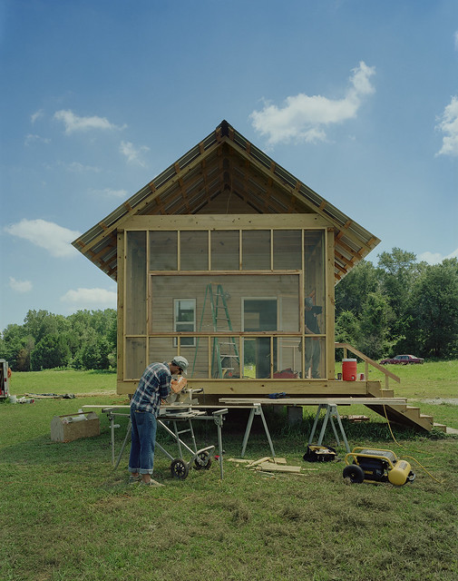 A student works on a Rural Studio house.