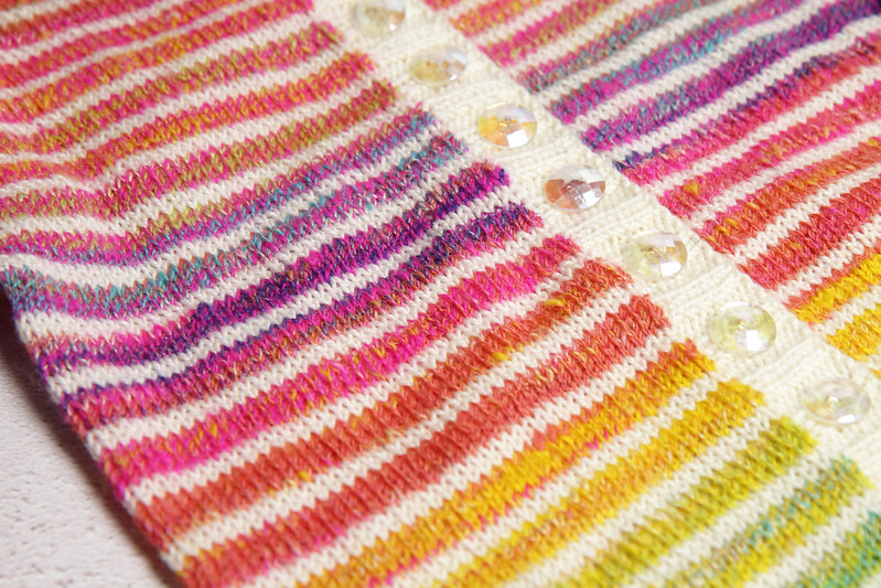 Close up of the rainbow gradient toddler cardigan