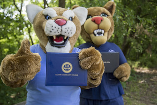 Bart the Cougar and Scooter the Cougar mascots in nursing scrubs