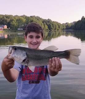 Photo of Boy holding a nice sized largemouth bass