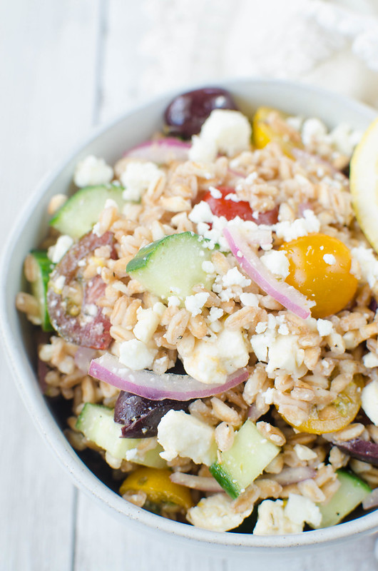 Greek Farro Salad - Farro, cucumber, tomatoes, kalamata olives, red onion and feta cheese tossed in a light lemony dressing. Perfect healthy lunch recipe!
