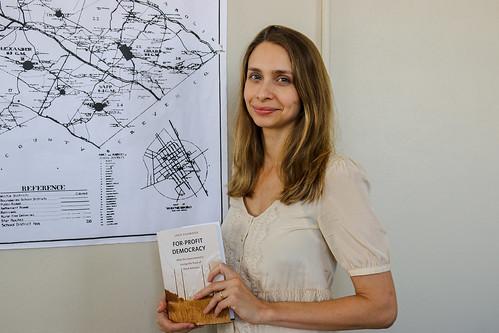 Loka Ashwood holds her book.