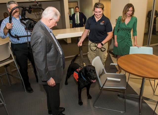 U.S. Attorney General Jeff Sessions looks at one of Auburn's canine detectors while others look on.