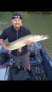 Photo of man holding Muskie