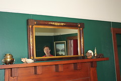 The current Bob Murrell in a mirror from the bar of the original hotel at Old Bob's Corner