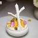 Tropical Pavlova 트로피칼 파블로바 - meringue, coconut mousse, fresh fruit, mango & passion fruit coulis, vanilla chantilly & coconut meringue stick