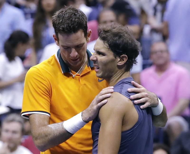 Rafael Nadal(右)因傷退賽,Juan Martin del Potro(左)晉級美網男單決賽。(達志影像)