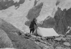 John Robert (Jack) Murrell at a campsite next to Age Glacier, Mount Tutoko, Darran Range, Southland Region