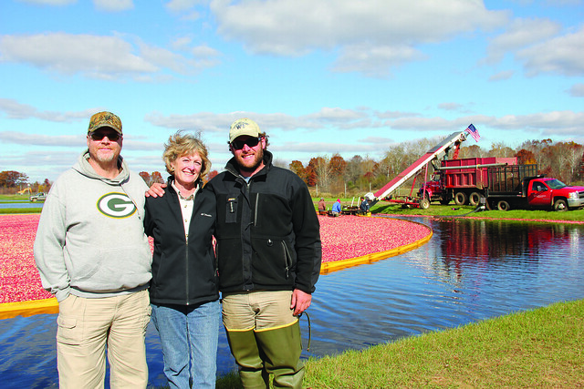 Roy Diver, NRCS District Conservationist; Mary Brazeau Brown, Glacial Lake Cranberries (GLC) President; and Stephen Brown, GLC Vice President