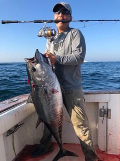 Man holding a nice bluefin tuna