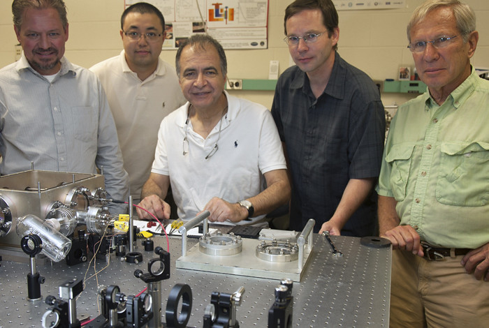 Staning from left to right are Markus Hehlen (PI, LANL), Junwei Meng (UNM), Mansoor-Sheik Bahae (UNM), Alexander Albrecht (UNM) and Richard Epstein (UNM).