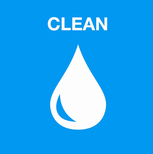 White water droplet on blue background with clean text