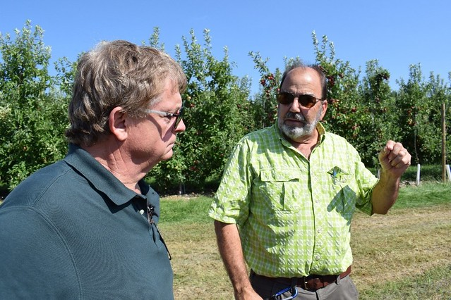 Martin Barbre (left), Administrator of USDA's Federal crop insurance program, meeting with Chris Baugher, owner of Adams County Nursery