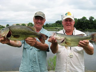 Two men holding largemouth bass