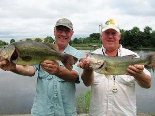 Two men holding largemouth bass