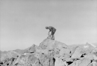 John Robert (Jack) Murrell building a cairn on the summit of Mount Elliot, Southland