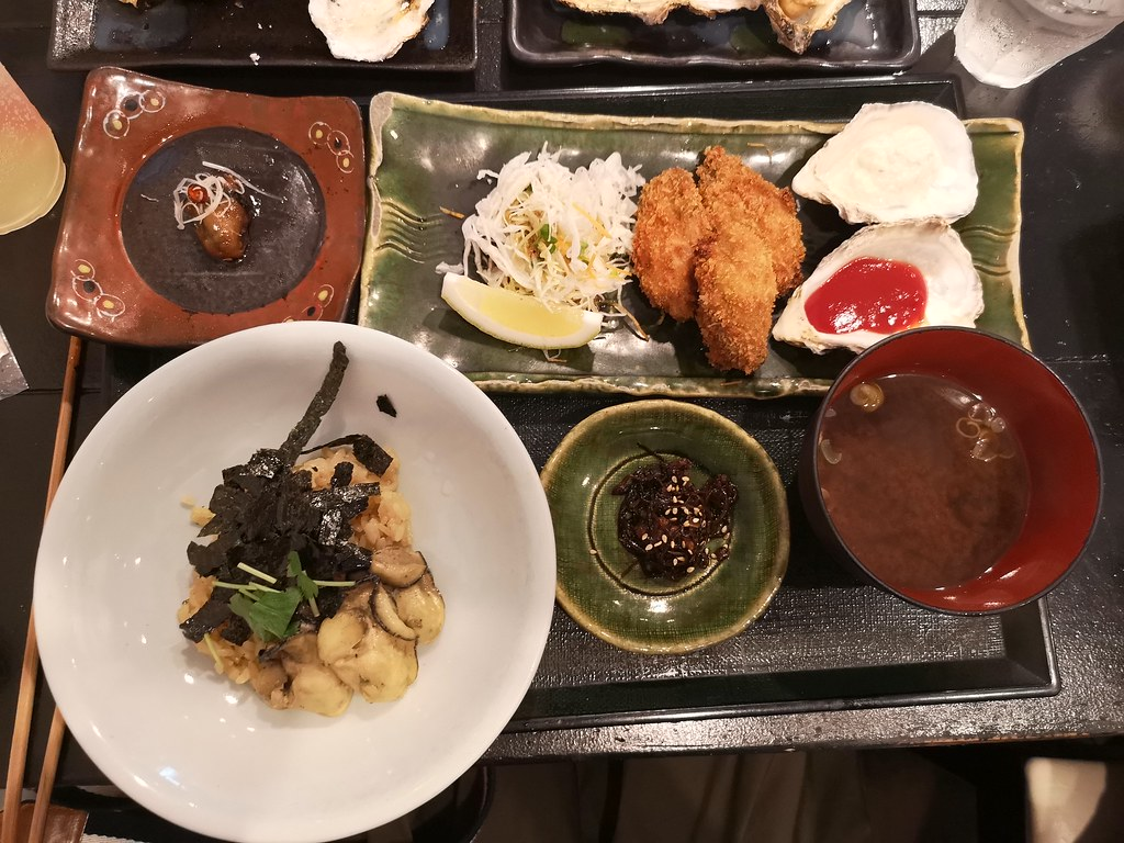 Our amazing oyster set meal comprises: red miso soup made from scratch with oyster broth, oysters preserved in grapeseed oil, a marinated oyster dish called tsukudani, fried oysters with a panko crust, and barbecued oysters (next pic). The set costs 2150 yen.