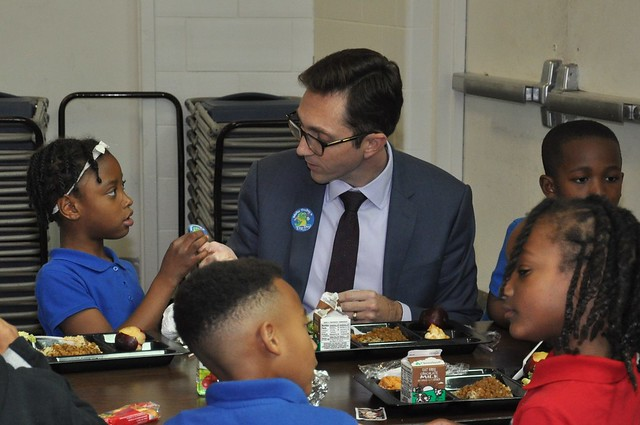 Acting Deputy Under Secretary Brandon Lipps eating his school lunch alongside students