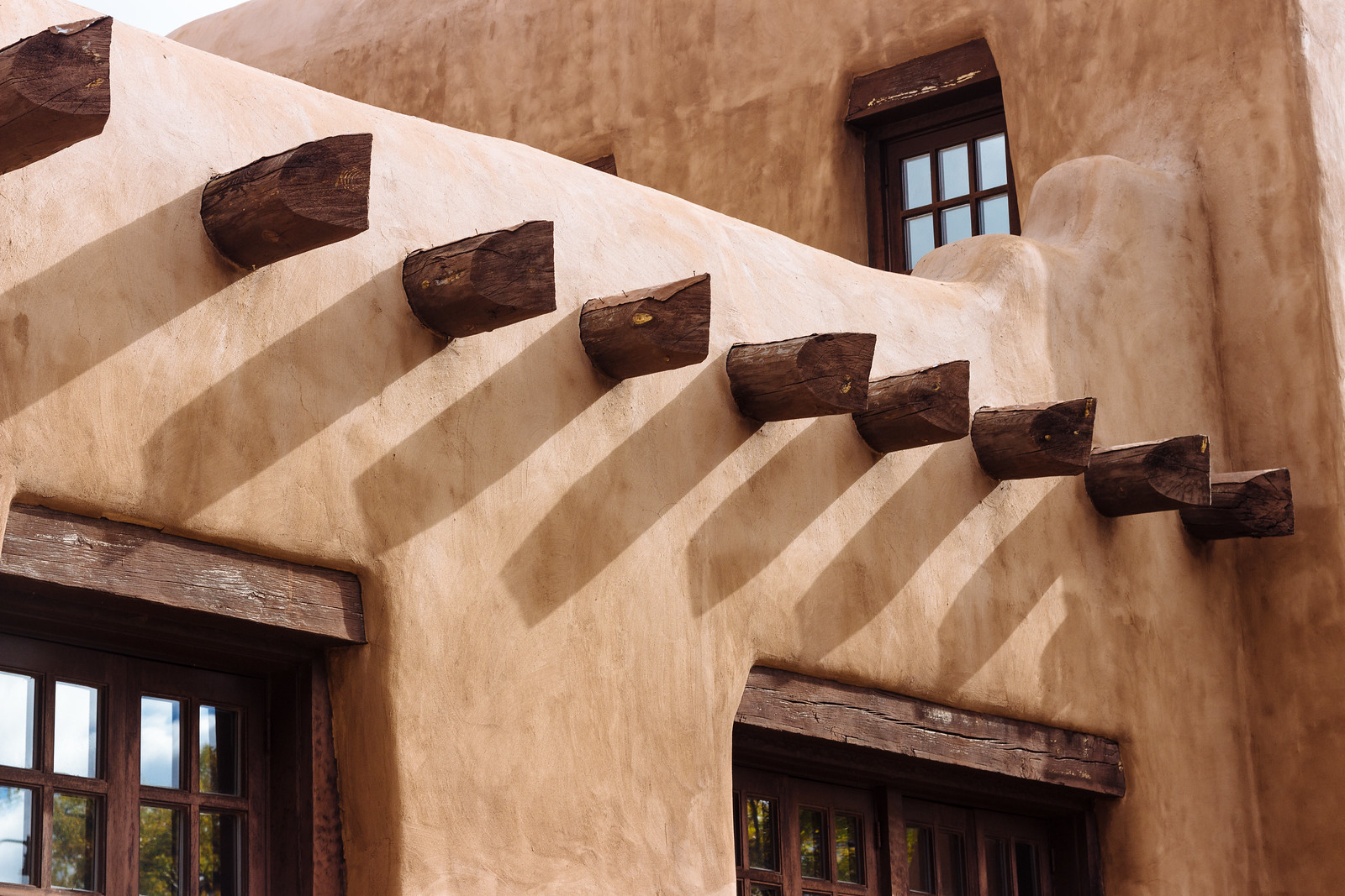 Adobe building with wooden beams in Santa Fe, New Mexico