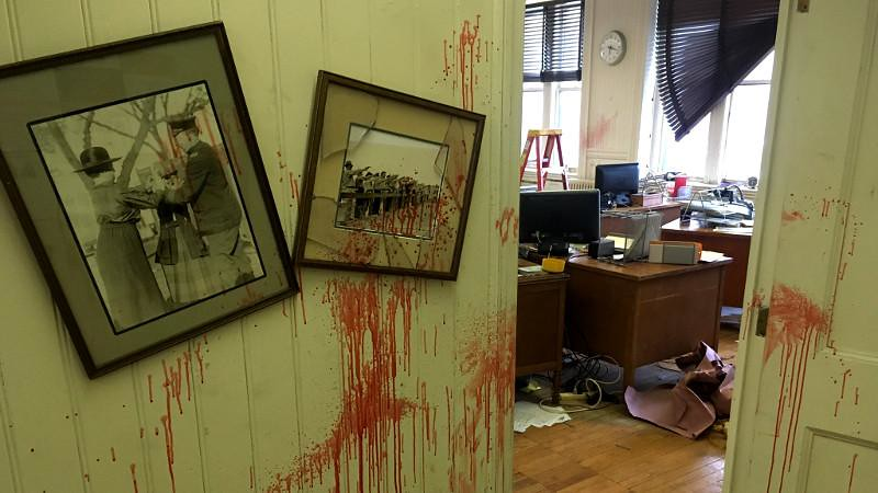 Office set with blood in the walls