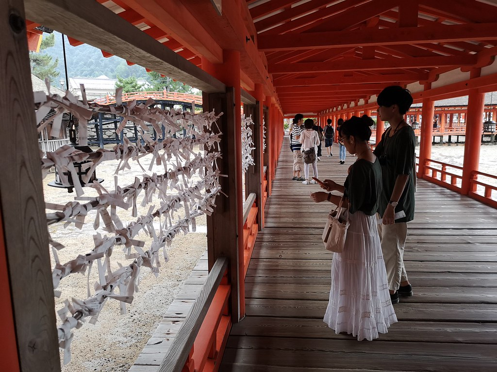 These white slips of paper represent the wishes made by devotees at Itsukushima Shrine.