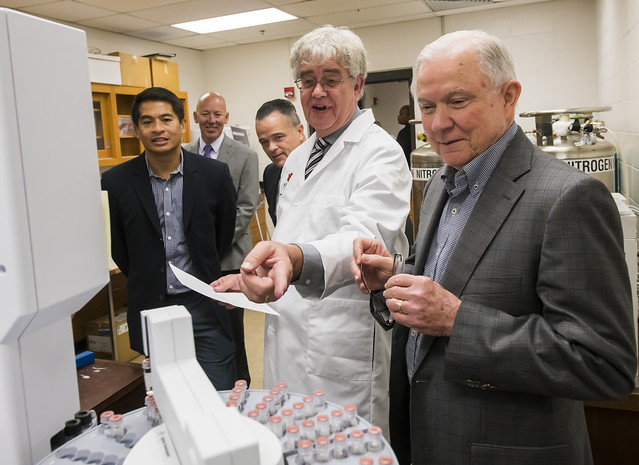 U.S. Attorney General Jeff Sessions is pictured looking at lab equipment.